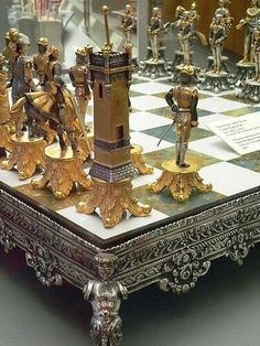 Silvered and Gilded Bronze Vasari Figural Chess Set rests on a board of silver framed polished Italian onyx