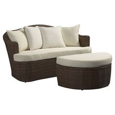 Lounge by the pool or enjoy a glass of vino with friends on this indoor/outdoor daybed and ottoman set, showcasing a woven wicker design and an aluminum fram...