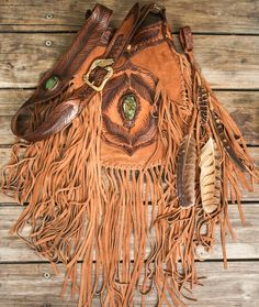 Handcrafted Apache Tasseled Bag in distressed leather with soft suede tassels featuring a large Quartz Crystal in the front panel & white Howlite in the strap. Topped off with a matching feather clip! Leather Gifts, Leather Bags Handmade, Leather Craft, Cute Purses, Purses And Bags, Estilo Hippy, Fringe Purse, Boho Bags, Hip Bag