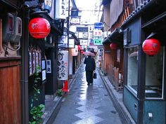 """Alley, Kyoto    Photograph by Devin Stoll, My Shot    Through Japan's modernizing efforts, large department stores and traffic-packed roadways have eclipsed the nation's traditional image and ideal. Here, narrow back alleys of downtown Kyoto are still very active, providing the area's finest in traditional cuisine. This local """"salaryman"""" selects an evening meal and contributes to the preservation of Kyoto culture.    (This photo and caption were submitted to My Shot.)"""