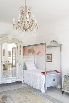 Shabby elegance!! Love the bed, armoire, chandelier