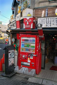 Old Coca-Cola vending machine made in the shape of a lovely robot. (Coke Bottle Shape)