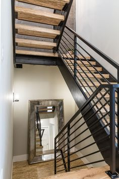 Industrial Modern Farmhouse Metal and reclaimed wood Staircase Paralam stairs with custom metal handrail and barnwood covered feature wall