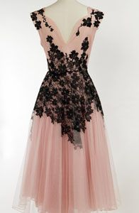 Pretty 1950's pink net gown with black appliqued floral lace.