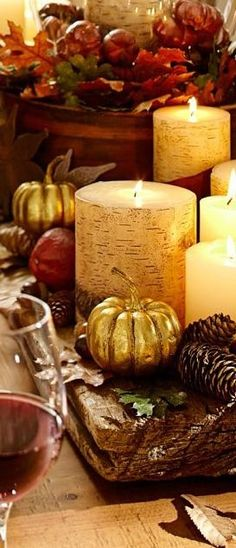 Autumn table Grouping chunky candles truly creates ambience...