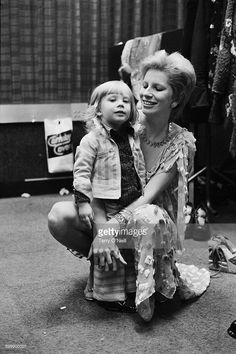Angie Bowie, wife of English singer-songwriter David Bowie, with their son Zowie (Duncan),  backstage during filming of 'The 1980 Floor Show', at the Marquee Club, London. The performance was filmed on 19th and 20th October 1973 for the American NBC TV show 'The Midnight Special'.
