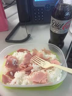Quick lunch in work- microwave boiled rice with 3 slices of cooked ham shredded through it.