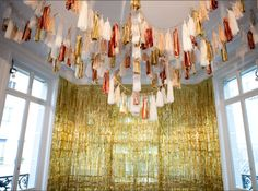 Tassels in the color scheme strung across the ceiling