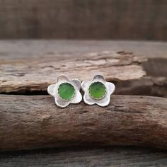 Check out this item in my Etsy shop https://www.etsy.com/listing/594493359/green-stone-earrings-dainty-flower
