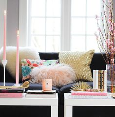 How to Style a Coffee Table:        Natural elements to add color and bring the outdoors in (especially you,  city dwellers)      Candlelight to add ambiance and possibly fresh scent to the room      Books to entertain visitors      Decorative accents to spark conversation among guests and add interest      Tray to organize the previously stated items