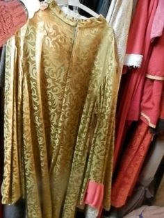 @ODWC brocade-y cloak. with red end of the sleeves.