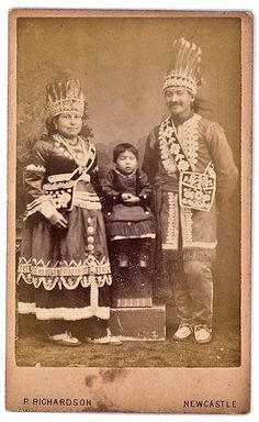 Iroquois Family, c. 1880  Note:  Both the man and woman are wearing bandoliers.