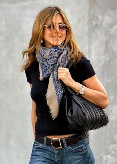 jennifer aniston - simple black tee, jeans, and printed scarf.