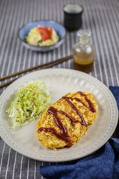 Japanese meal, Omu-rice: an omelet with a filling of ketchup‐seasoned fried rice.
