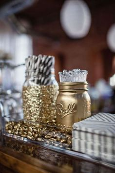 Simple & Easy..Golden, glittering mason jars, anyone? It's a humble decoration at heart, to be sure, but gold spray paint and glitter-filled insides transform these simple jars into pieces fit for a great gala. I love the idea of placing them in a glass tray of fools' gold, too. (p.s. Black and gold? Always a win.) #newyear's #2014party #newyearstables