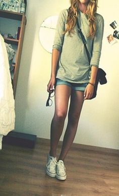 I love this - so casual, yet so cute!!  Perfect college wear: Gray, oversized long-sleeve tee, cuffed, light wash denim shorts, black messenger bag, white converse, and messy, wavy hair.