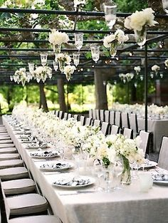 White flower centerpiece / Long tables / Outdoor event