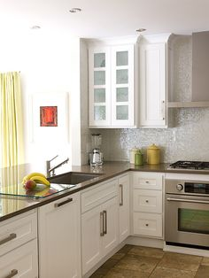 You can can make the kitchen feel bigger by removing part of a wall separating the kitchen from the adjoining room....