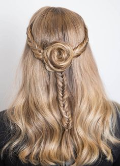 This fishtail flower braid is a cute feminine twist on regular headband braids.