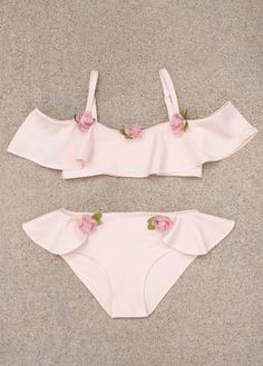Featuring a lovely off the shoulder ruffle detail, and dainty rose-hued flowers, this swimsuit is the perfect statement for the summer months.