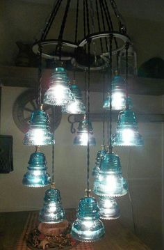 Horse shoe and glass insulator chandelier