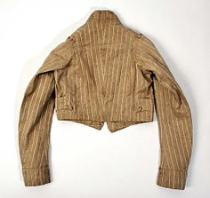 Jacket Date: ca. 1818 Culture: British Medium: cotton Dimensions: Length at CB: 16 3/8 in. (41.6 cm) Credit Line: Purchase, Irene Lewisohn Trust Gift, 1983 Accession Number: 1983.153