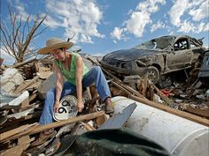 Susan Kates salvages items from a friends home. Charlie Riedel, AP
