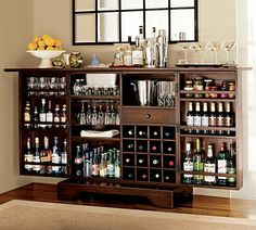 Pottery Barn Modine Bar. This beast of a fold-out bar offers tons of storage, including a 16-bottle wine rack, three fixed shelves with gallery rails to hold an assortment of barware, a plastic drip tray to protect the innards from moisture, a removable bar tray, and more, all with a mahogany frame with matching veneers and hidden wheels for easy mobility. Cheers.