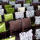 Brown, green and light purple chair covers with varying textures enhance the enchanted forest feeling.