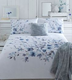Perfect for adding a sophisticated splash of colour, this duvet cover is designed by John Rocha and features a painterly floral print in deep blue and purple hues. The neutral white cotton base is ideal for complementing the bold watercolour style print.
