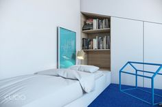 A blue accented bedroom brings some light relief in the serious home scheme, perfect for a younger family member.