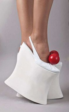 crazy shoe.... ~ OK, so what do you say about THIS?!!  Way over the top and the designer should be made to walk a mile in them !