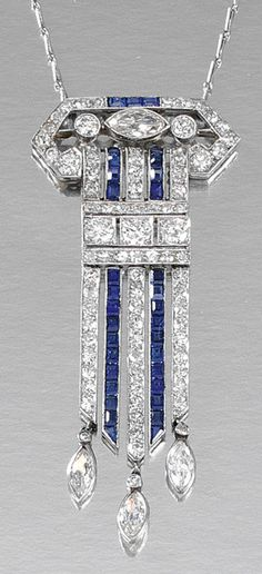SAPPHIRE AND DIAMOND PENDANT, 1920S. Designed as an articulated geometric pendant, millegrain-set with circular-, single-cut and navette-shaped diamonds, embellished with lines of calibré-cut sapphires, suspending three navette-shaped collet-set diamond drops, to a trace link chain, length approximately 460mm.