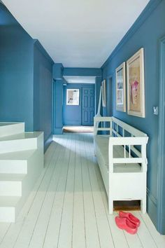 White walls and floors—with everything blue in between—create a backdrop for standout steps, crown molding, and other defined details. Shown here: Cook's Blue from Farrow & Ball | Photo: Courtesy of Farrow & Ball | thisoldhouse.com