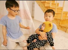 Minguk and Daehan take care of a little baby