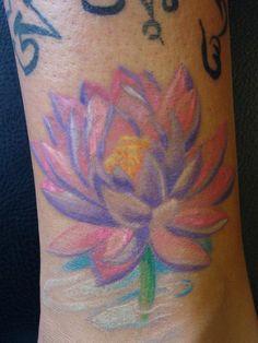 Love this lotus tattoo