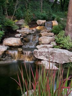 Rustic Landscape/Yard with Weathered Landscape Boulders, Custom Pond and Waterfall Features