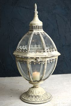 Laurel Metal and Glass Lantern 21.5in Ant.Wht. A beautiful antique look that would be perfect for a vintage wedding