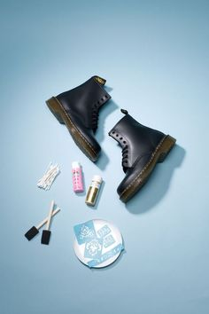 DIY Baroque-Inspired Boots.     What you need: Dr. Martens combat boots, Acrylic craft paint in pink and gold, Reusable adhesive stencils, Two 1-inch foam brushes, Q-tips, Plastic plate
