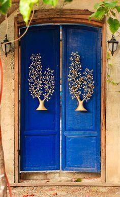 BEAUTIFUL BLUE DOORS WITH GOLD TREE IN EACH!