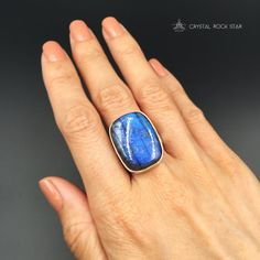 """Wear this magical flashy crystal as an everyday modern statement piece that goes with any wardrobe style. The thick and chunky rectangular labradorite crystal cabochon set in this ring features shades of cobalt and electric blue.  I love wearing labradorite rings for empathic protection when stepping out in public! If you're a lover of labradorite, consider the beautiful energies of this chatoyant blue ring!  Ring Size: 7 Stone Size: 25mm x 20mm (0.98"""" x 0.79"""")"""