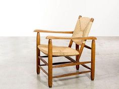 PERRIAND Charlotte (1903-1999) straw armchair - Circa 1935 Legs and solid wood frame, seat and backrest in weaving p ...