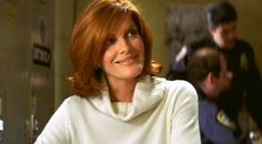 Rene Russo in Thomas Crown Affair; love the hair