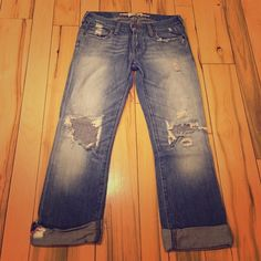 """Abercrombie and Fitch distressed denim capris Fun """"destroyed"""" look. The kind your grandma likes to wonder why you """"bought it like that?!?!"""". Size 2. Loved these but time to share the love!  Abercrombie & Fitch Pants Capris"""