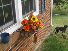 I gave in and used the fake flowers for my window boxes..Hey I cant kill these!