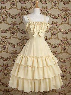 <メアリーマグダレン>2013年?発売 コピーヌジョーゼットドレス Product code:252-0105  しなやかで触り心地の良い梨地ジョーゼットを使用したハイウエスト切替のドレスです。 スカートの3段フリルから覗いたソフトチュールが儚げで優しい雰囲気を醸し出します。 Color number 1.ブラック    2.生成    3.スモーキーローズ    4.ピーコック     Price:26,040(本体価格 \24,800)