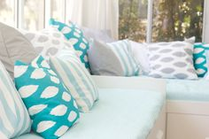 love this group of turquoise, grey and white pillows