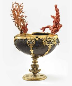 COPPER-MOUNTED COCONUT CUP WITH SEMI PRECIOUS STONES, CORAL AND ENAMEL, SPANISH, 17TH CENTURY