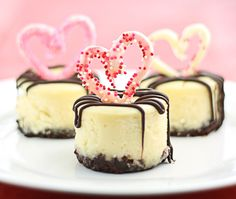 Mini Cheesecakes with a Nutella crust, topped with chocolate hearts & a chocolate-stuffed raspberry center. They really are the Best Mini Cheesecakes Ever!