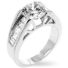 Genuine Rhodium Plated Classic Engagement Ring with Round Cut Cubic Zirconia Center Stone and Channel Set Baguette Accent Cubic Zirconia Polished into a Lustrous Silvertone Finish